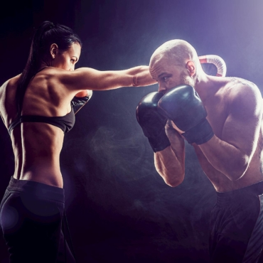 shirtless-woman-exercising-with-trainer-boxing-self-defense-lesson-female-male-fight-m